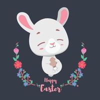 Easter bunny relaxing with festive egg in their hands vector