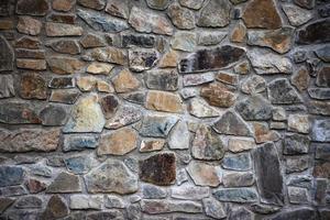 Wall of stone blocks photo