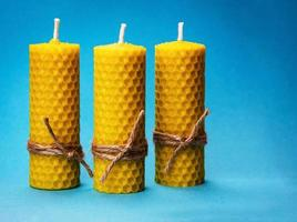 Beeswax candles on blue