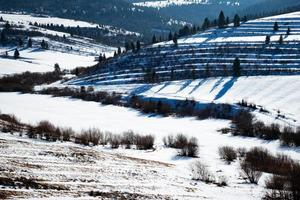 Rugged hilly winter landscape photo