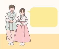 los niños con trajes tradicionales coreanos están de pie y saludando. vector