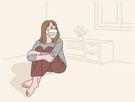 A woman is sitting alone in a room wearing a mask. vector