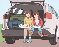 Cute little sisters are sitting in the trunk behind the car and looking at the map. vector