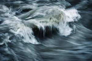 Dramatic wild river waves photo