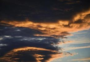 Dark clouds at sunset photo