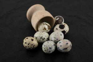 Fresh farm quail eggs out of wooden box photo