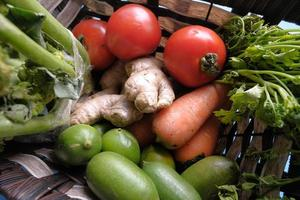 Bowl of fresh vegetables on table photo