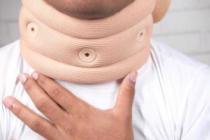Man wearing a neck brace close up photo