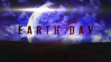 animação closeup texto do dia da terra com planeta de movimento e nuvens azuis mágicas na galáxia