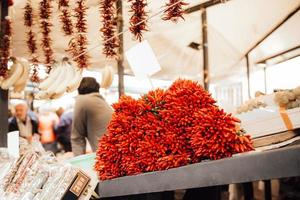 A bunch of crispy chili peppers photo