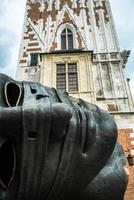 Krakow, Poland 2017- Bronze monument sculpture head in the market square of Krakow