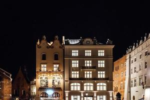 Krakow, Poland 2017- Old commercial area of Krakow in the lights of street lamps photo