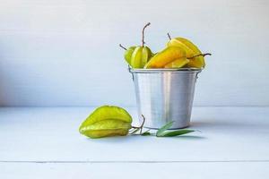 Star fruit in a bucket photo