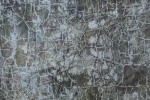 Cracked dark concrete photo