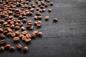 Coffee beans on a black background photo