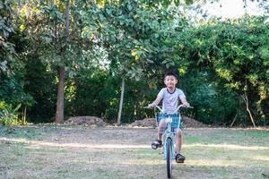 Boy riding a bike photo