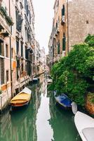 Narrow canals of Venice Italy photo