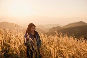 Woman on a mountaintop at golden hour photo