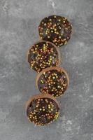 Chocolate sweet doughnuts with sprinkles photo