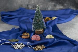 A Christmas tree toy with colorful doughnuts photo