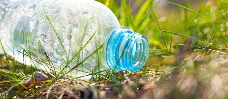 Empty plastic bottle on ground photo
