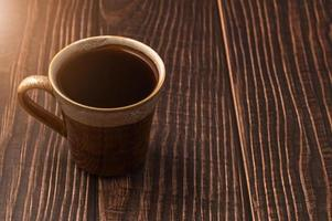 A coffee cup on a wooden table photo