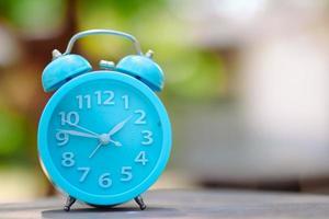 Blue alarm clock outside photo