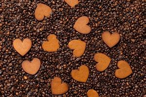 Heart-shaped gingerbread cookies on the coffee beans background photo