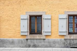 Windows with shutters on the wall of an old building in Geneva, Switzerland photo