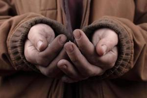 Beggar's hands cupped together photo