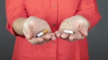 Broken cigarettes in hands