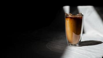 Iced coffee with milk on the table photo