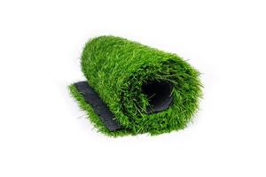 Roll of artificial grass isolated on white background. photo