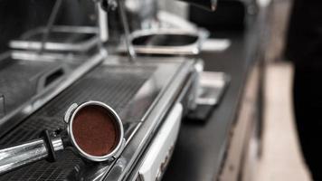 Coffee tamper on coffee machine photo