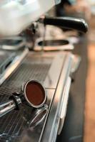 Coffee tamper on a coffee machine photo