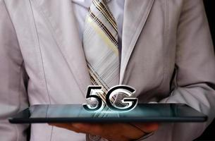 Businessman holding tablet, 3D technology networks concept photo