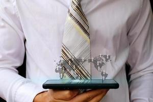 Businessman holding smartphone and technology network concepts photo