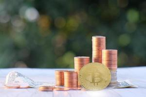 Bitcoin cryptocurrency coin and euro coin on table photo
