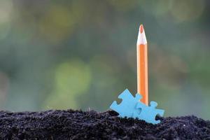 lápiz de primer plano y concepto de idea de negocio foto