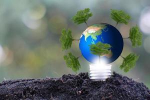 Light bulb, save world and business eco concept photo