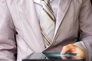 Businessman using a smartphone and technology network concepts photo