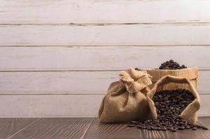 Bags of coffee beans on a wooden table photo