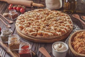 Brazilian pizza with mozzarella, chicken, catupiry and oregano photo