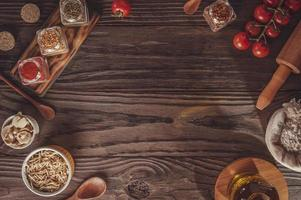 Top view of table with tomato, champignons, potato sticks, ingredients and space