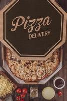 Pizza with barbecue sauce, grilled chicken, onion and oregano in delivery box photo