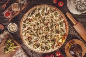Pizza with mozzarella, broccoli, catupiry and parmesan photo
