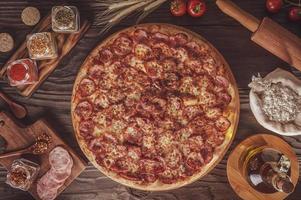 Pizza with mozzarella, calabresa sausage and oregano photo