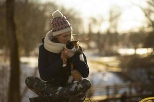 A young athletic woman holding cat outdoors photo