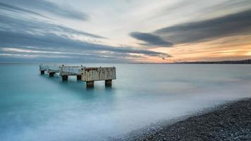 Long exposure of a beach during sunset in Nice, France