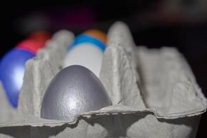 Close up of pearl-colored eggs for Easter in an egg tray